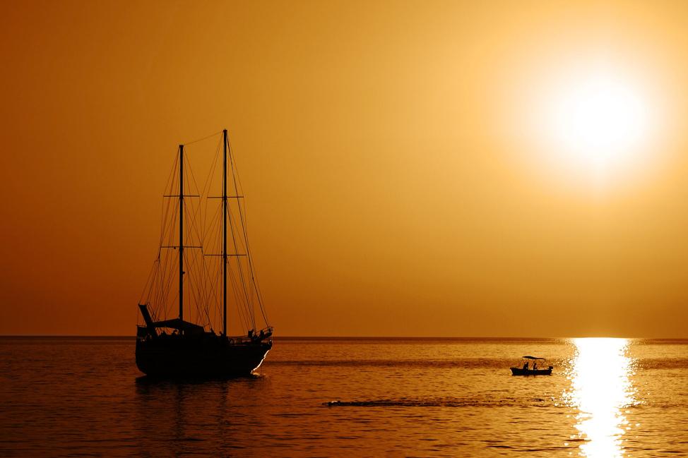 Image description: Boat at sunset