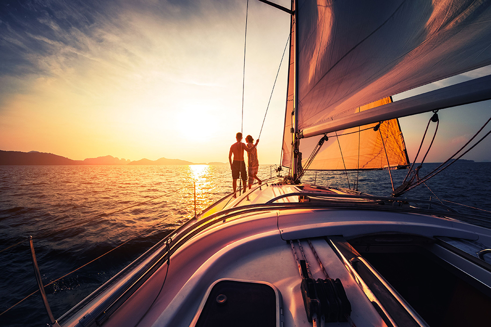 Image description: People on boat at sunset