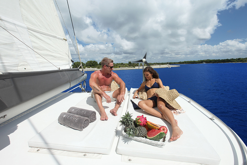 Image description: People relaxing on boat